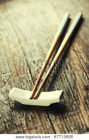 pair of chopsticks on rustic wooden background