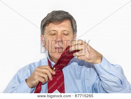 Business Man Binds His Tie