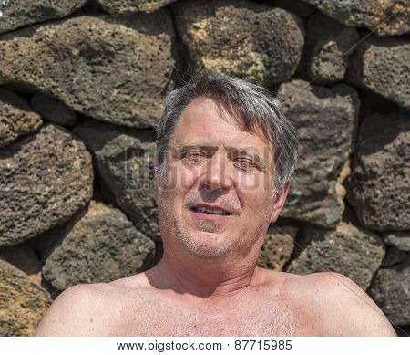 Portrait Of Handsome Man Relaxing In The Outdoor Area