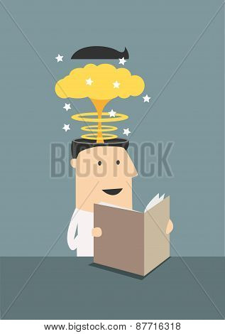Businessman reading book with brain explosion