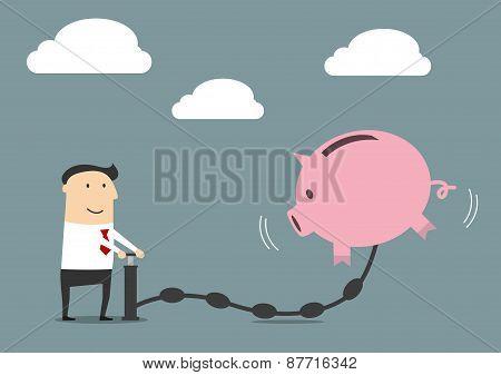 Businessman putting money to a piggy bank