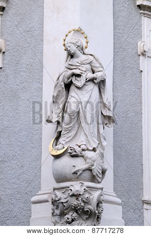 GRAZ, AUSTRIA - JANUARY 10, 2015: Virgin Mary, statue on the house facade in Graz, Styria, Austria on January 10, 2015.