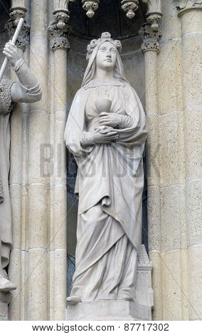 ZAGREB, CROATIA - APRIL 04: Statue of Saint Barbara on the portal of the cathedral dedicated to the Assumption of Mary and to kings Saint Stephen and Saint Ladislaus in Zagreb on April 04, 2015