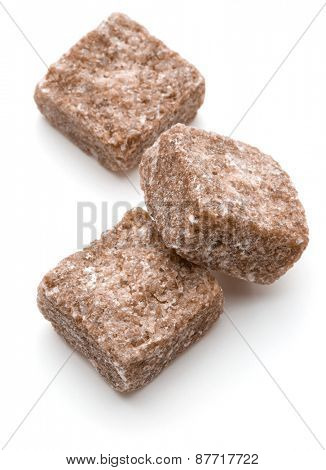 Brown lump cane sugar cube isolated on white background cutout