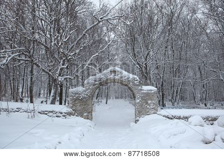 Russian winter. Cemetery gate in the town of Izborsk near Pskov, Russia.