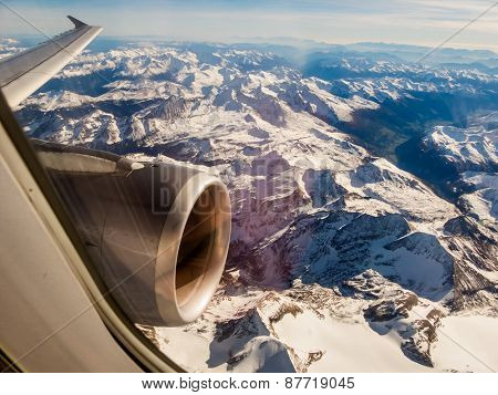 seen the alps in austria from an airplane in a flight from