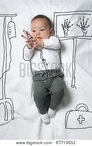 Cute baby boy decorated as a doctor concept