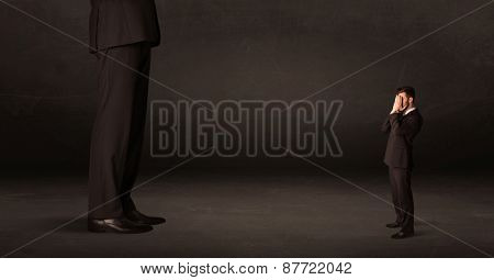 Huge man with small businessman standing at front concept on background