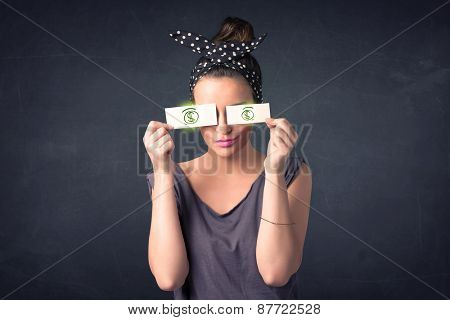 Young girl holding paper with green dollar sign concept