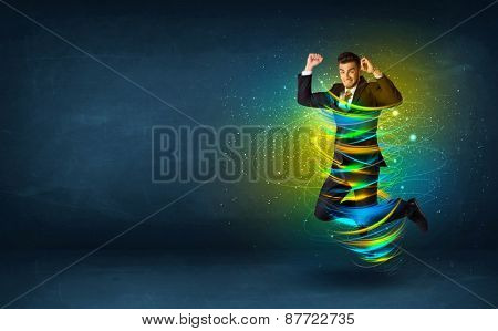 Excited business man jumping with energy colourful lines around him