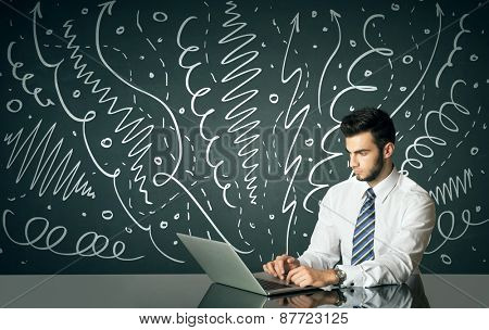 Businessman sitting at table with drawn curly lines and arrows on the background