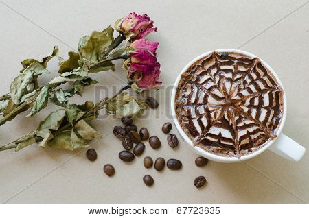 A Cup Of Coffee With Latte Art And Wither Rose On Brown Paper Background