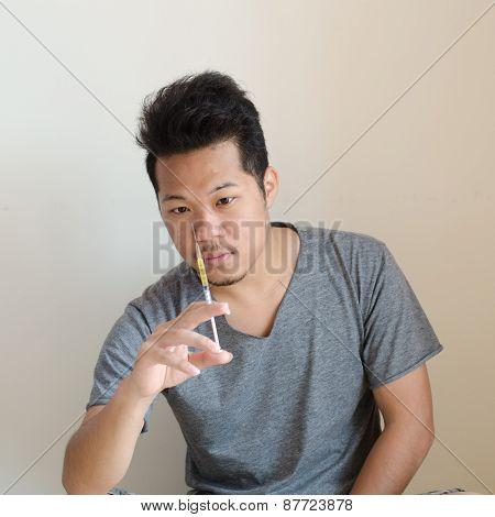 Drug Addict Man With Syringe In Hand