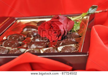 Chocolates And Rose On Red
