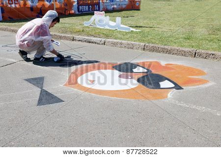 Perm, Russia - Jun 6, 2014: Guy Paints Graffiti By Balloon On Asphalt At White Nights Festival