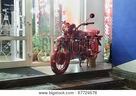 Perm, Russia - Jan 11, 2013: Red Motorcycle Near Shop Fashionable People. Fashionable People - First
