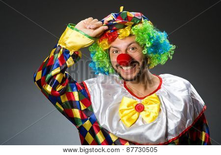 Funny clown in colourful costume