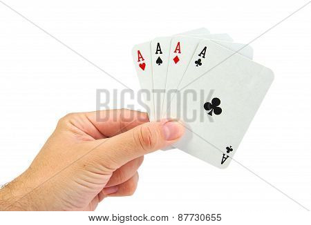 Hand with four aces isolated on a white background