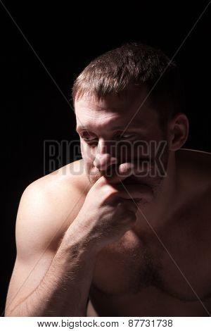 Image of shirtless man keeping his hands by face