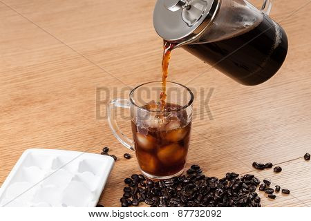 Pouring Coffee Onto Ice