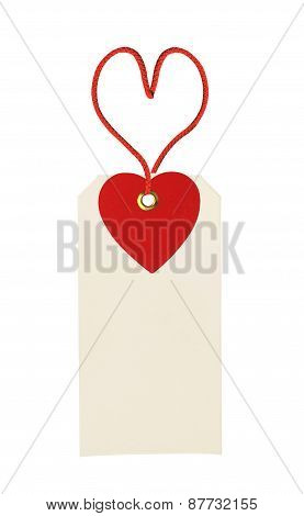 Cardboard Tag With Red Heart Ribbon Isolated On White Background