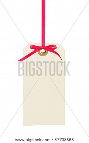 Cardboard Tag With Red Ribbon And Bow Isolated On White Background
