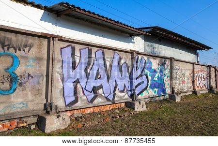 Colorful Graffiti Over Old Abandoned Concrete Fences