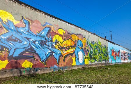 Colorful Graffiti On Old Gray Concrete Garage Walls