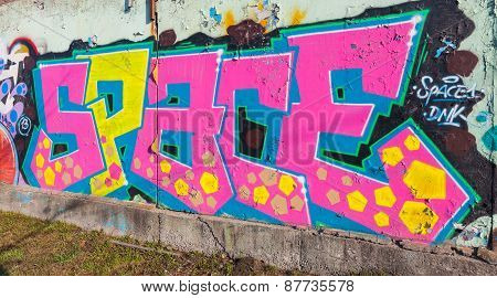 Colorful Graffiti Over Old Gray Concrete Garage