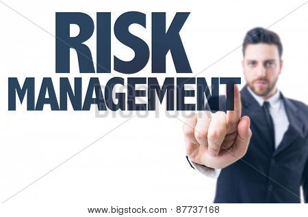 Business man pointing the text: Risk Management