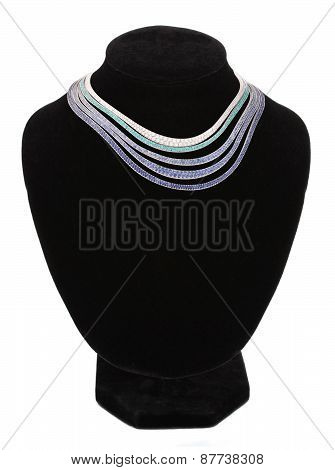 Necklace On Black Mannequin Isolated On White Background