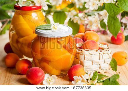 Jars of apricot and peach preserves