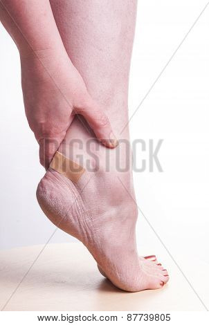 Woman With Patch On The Ankle