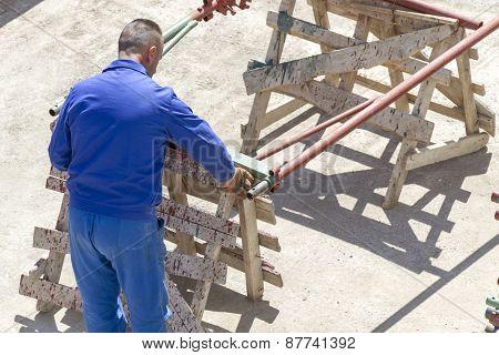 Paint Worker Painting Metal Designs