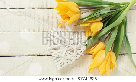 Background With Fresh Tulips And White Decorative Heart