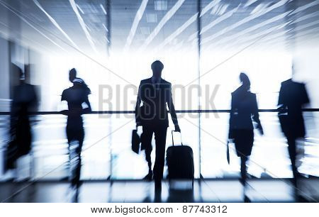 Several silhouettes of businesspeople