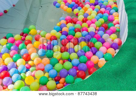 Colorful Plastic Ball Floating On Water In The Pool