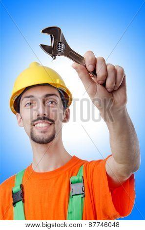 Repairman in coveralls in industrial concept