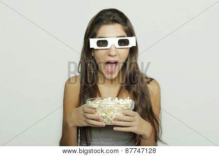 Young woman watching a movie. Cinema concept