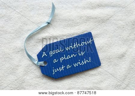 Goal Without Plan Is A Wish On Blue Label Sand Background