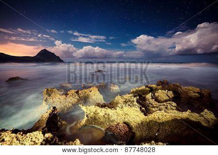 Fantastic view of the nature reserve Monte Cofano. Dramatic scene. Creative lighting. Location cape San Vito. Sicilia, Italy, Europe. Mediterranean and Tyrrhenian sea. Beauty world.