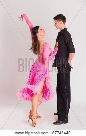 Ballroom dancers dancing. Dancers on a light background