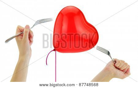 Forks about to pop a heart balloon isolated on white
