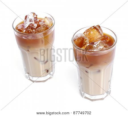 Glass of cold coffee on a white background