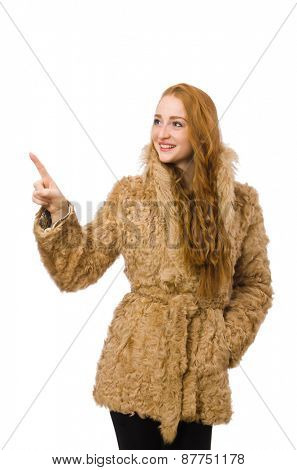 Redhead girl in fur coat isolated on white