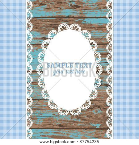Set of white lace frame doily and ribbons on a blue wooden background