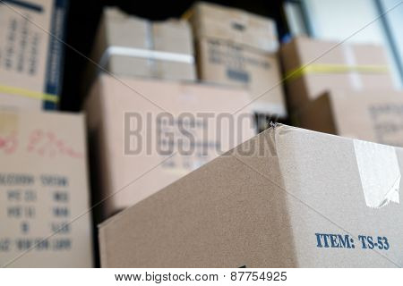 Pile Of Brown Cardboard Boxes At Warehouse Of Market