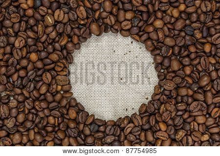 A Handful Of Coffee Beans On Sackcloth