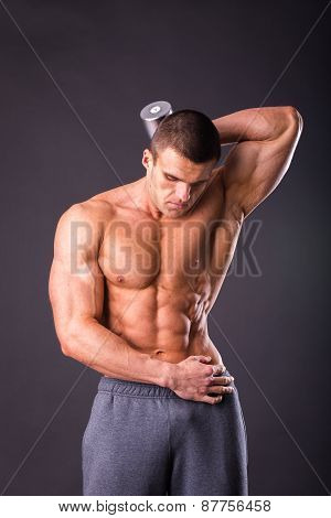 Man makes exercises dumbbells. Sport, power, dumbbells, tension, exercise.