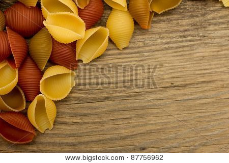 Shell Pasta On Wooden Table Top View Left